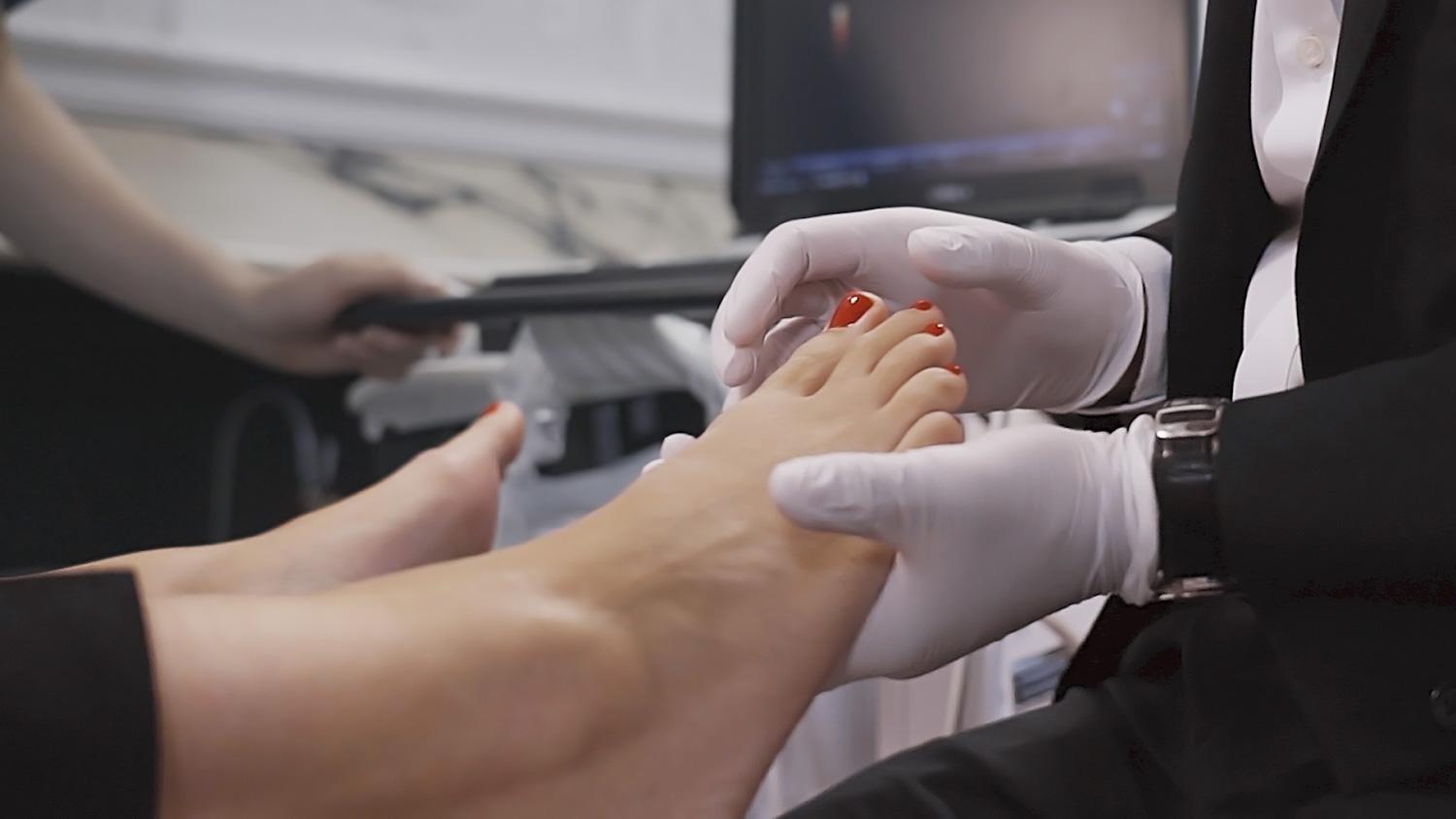 Image of Mr. Kaser Nazir, Bunion Surgeon, during a foot examination in clinic